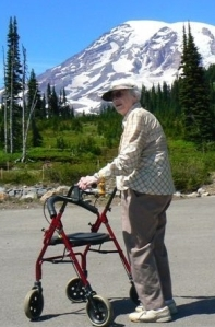 Faith Callahan with her walker, Mount Rainier in background